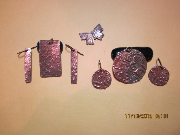 """some examples of the """"goldie"""" bronze metal clay."""
