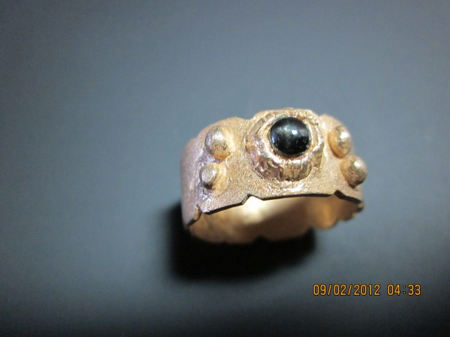 """goldie"" bronze ring with fired in place Black Star Diopsile."
